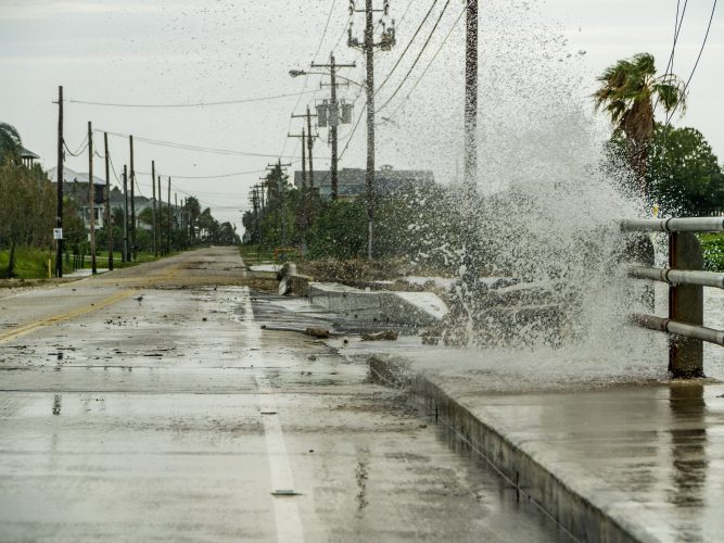 Water crashing over a road near Galveston Bay just outside of Houston Texas